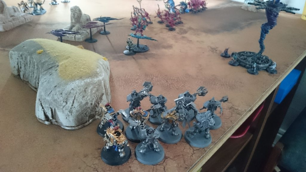 Then, with a crack of thunder, a unit of Paladin Retributors descend from Azyr on bolts of lightning. Tzeentchian magic keeps them from making landfall close to the first shard, but they now pose an immediate threat to the Herald.